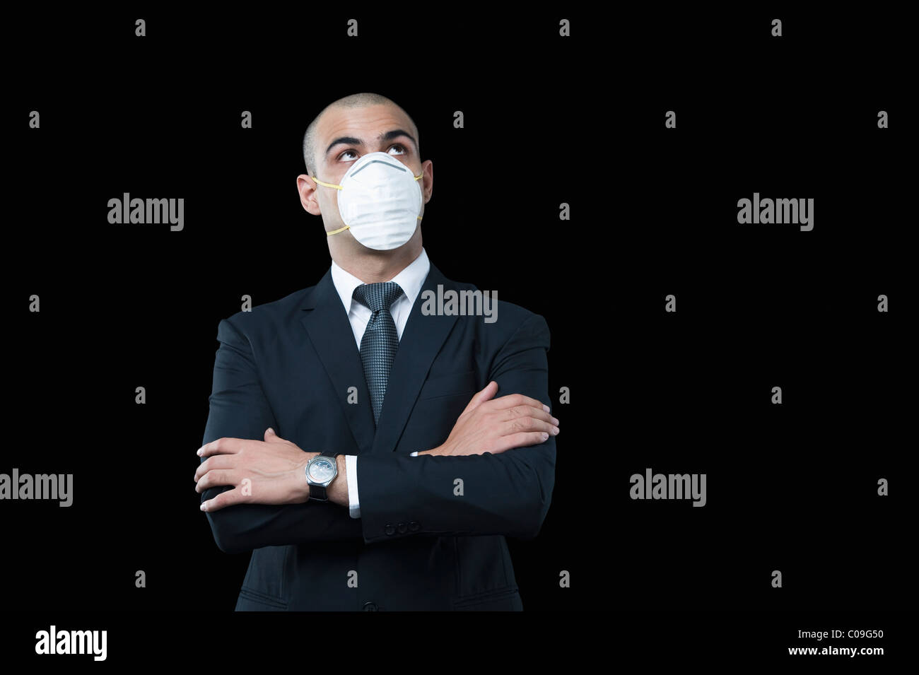 Businessman wearing a pollution mask - Stock Image