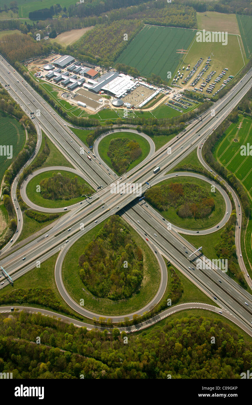 Aerial view, interchange Unna, A44 and A1 motorways, equestrian facility Reiterhof Massener Heide, Unna, Ruhrgebiet - Stock Image