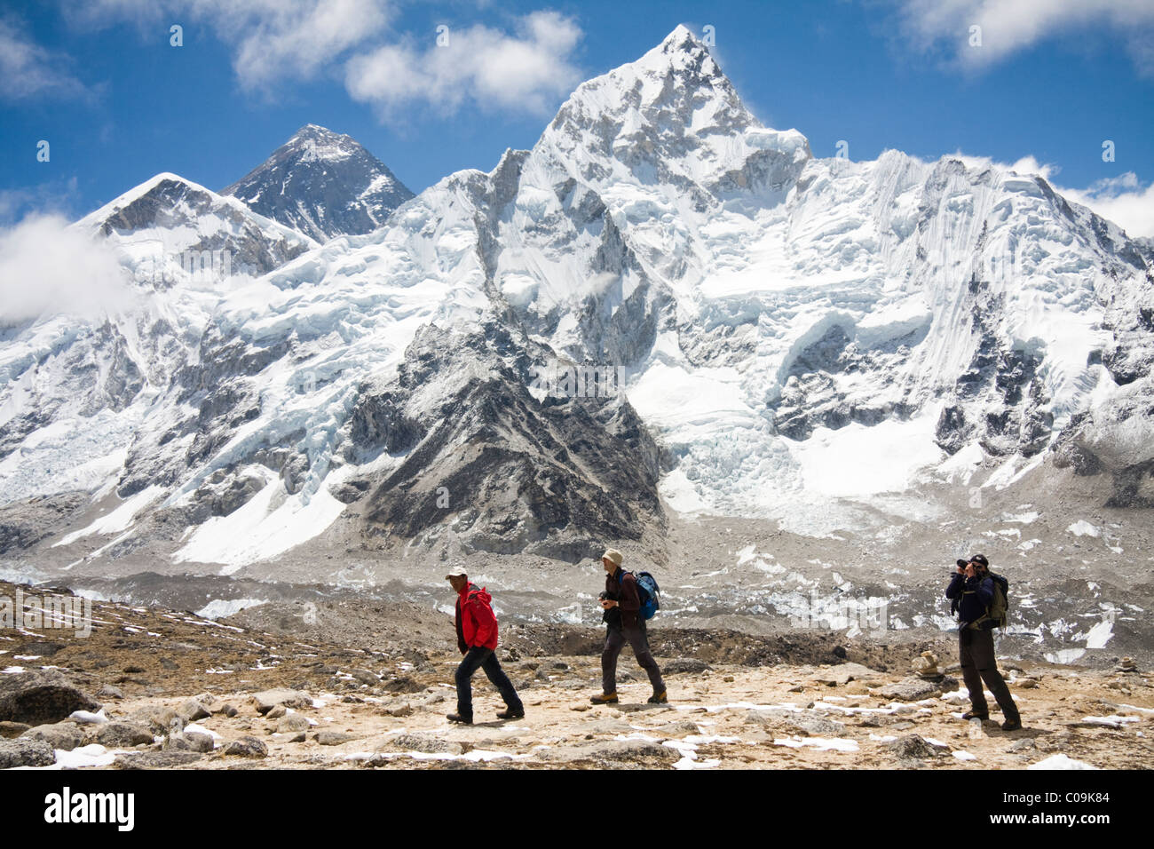 Trekkers with Mount Everest and Nuptse from Kala Patthar, Khumbu region, Himalaya Mountains, Nepal. - Stock Image
