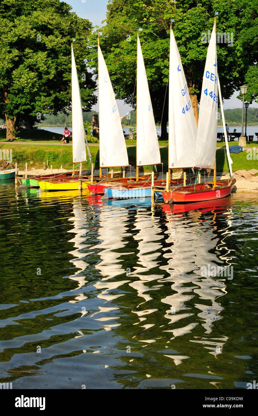 Colourful sailing boats in the harbor of Prien on Lake Chiemsee, Chiemgau, Bavaria, Germany, Europe Stock Photo