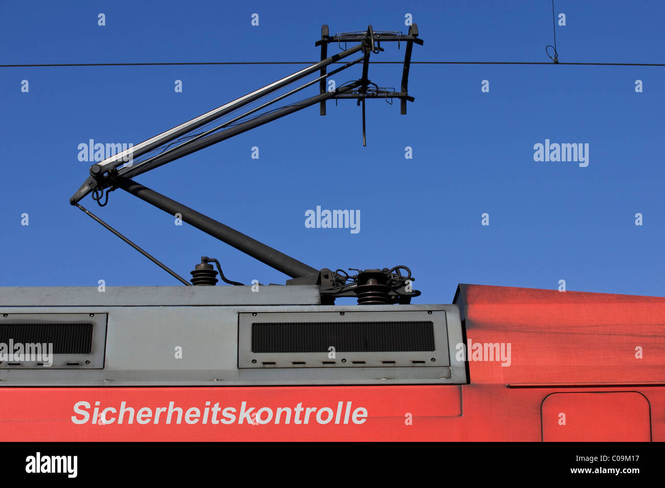 Train, power car with pantograph, writing 'Sicherheitskontrolle' security check, composing - Stock Image