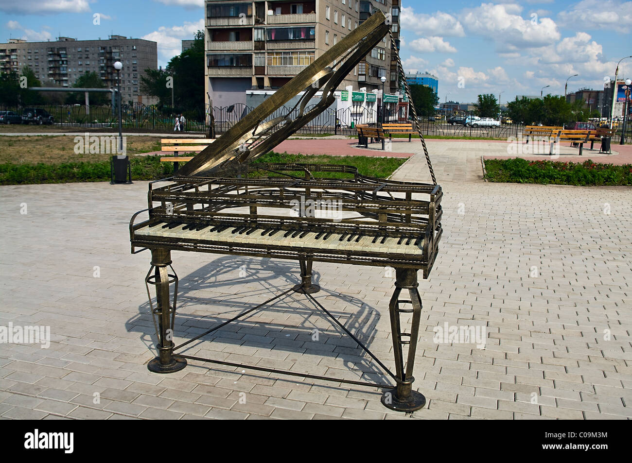 Musical statues a instruments from bronze in street of Chelyabinsk, Russia. - Stock Image