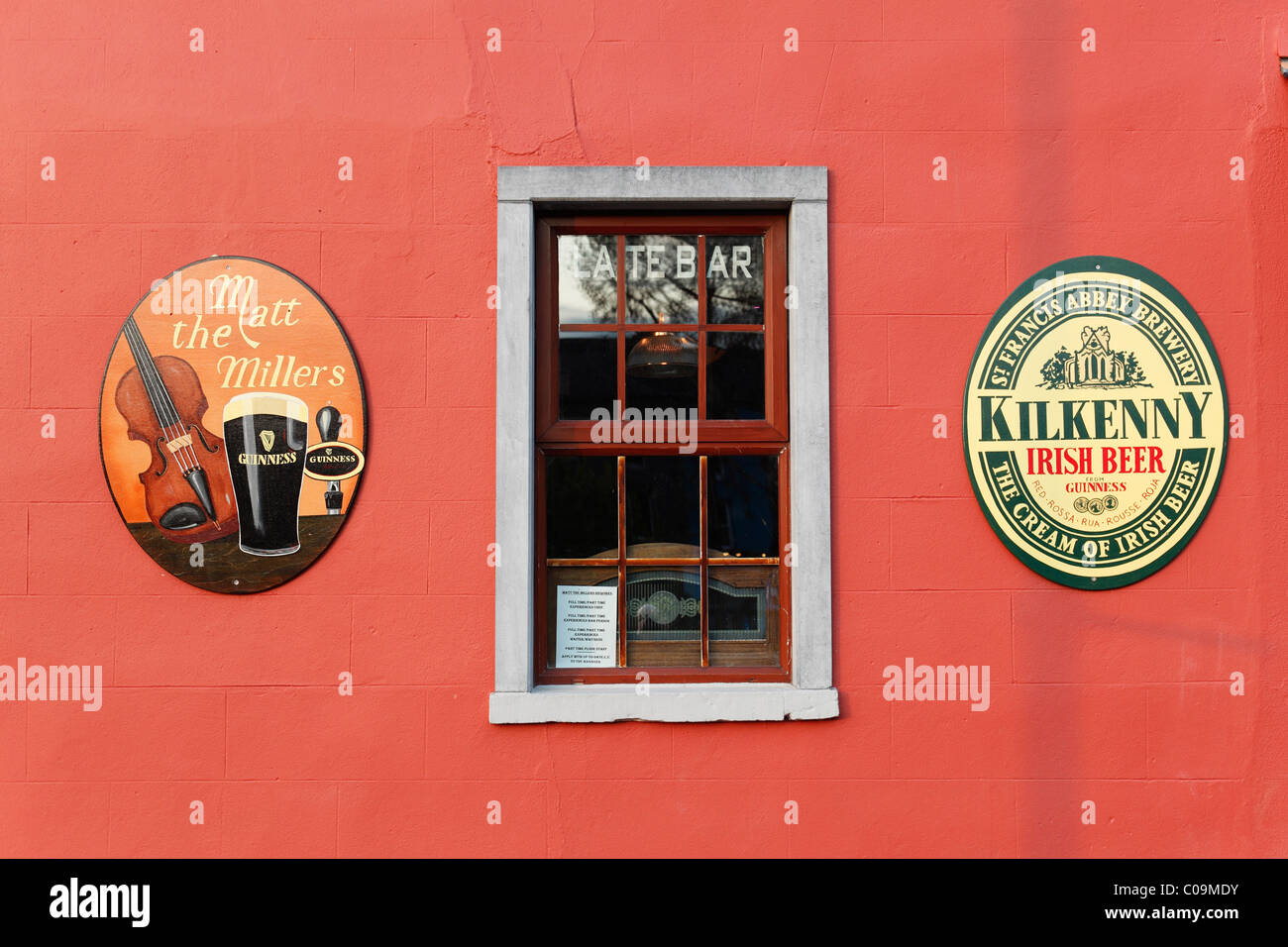 Outer wall of a pub, Matt the Miller, emblems of Guinness beer and St. Francis Abbey Brewery, Kilkenny, County Kilkenny, - Stock Image