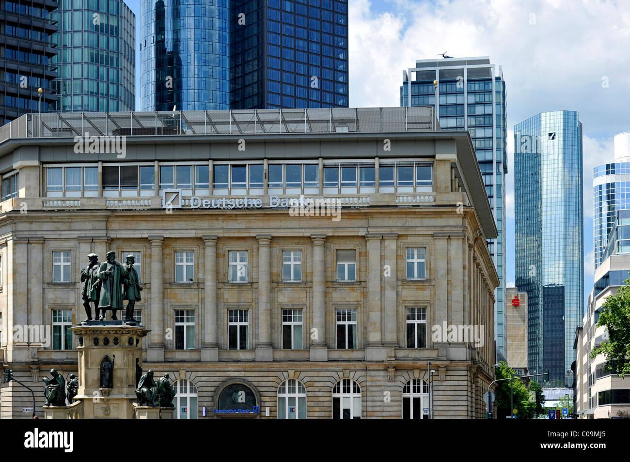 Johannes Gutenberg monument, branch of the Deutsche Bank German bank, and skyscraper headquarters of the Deutsche - Stock Image