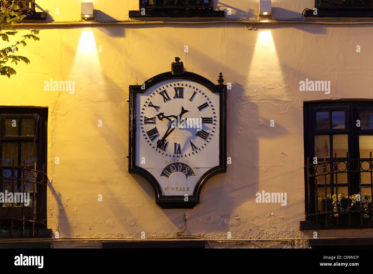 Old clock on the BLU The Blue Haven restaurant, Kinsale, County Cork, Republic of Ireland, British Isles, Europe - Stock Image