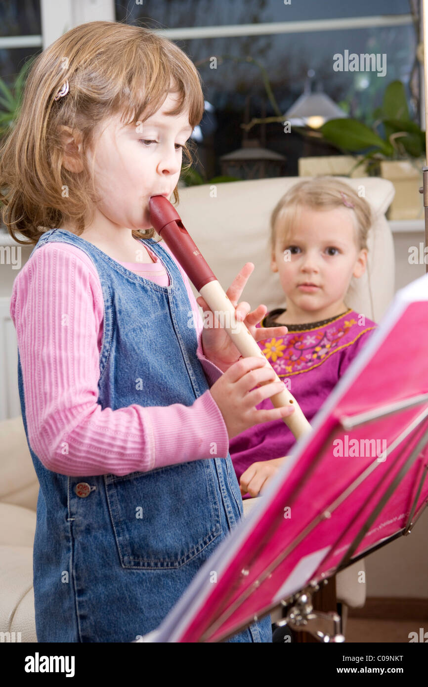 Two Girls One Girl Playing A Flute