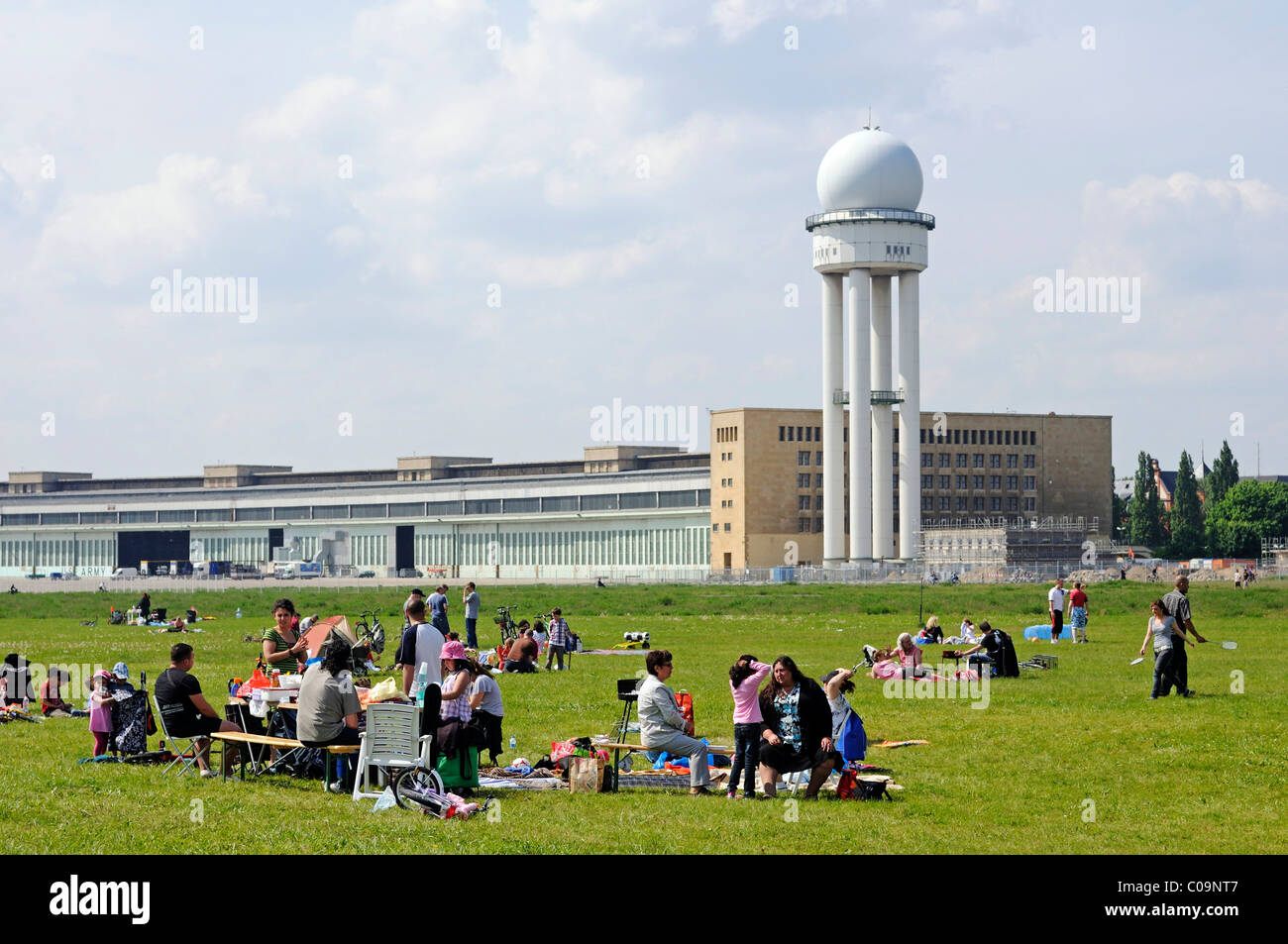 Families at a barbecueing area, in the back the radar tower of Tempelhof Airport, handed over to the public in May - Stock Image
