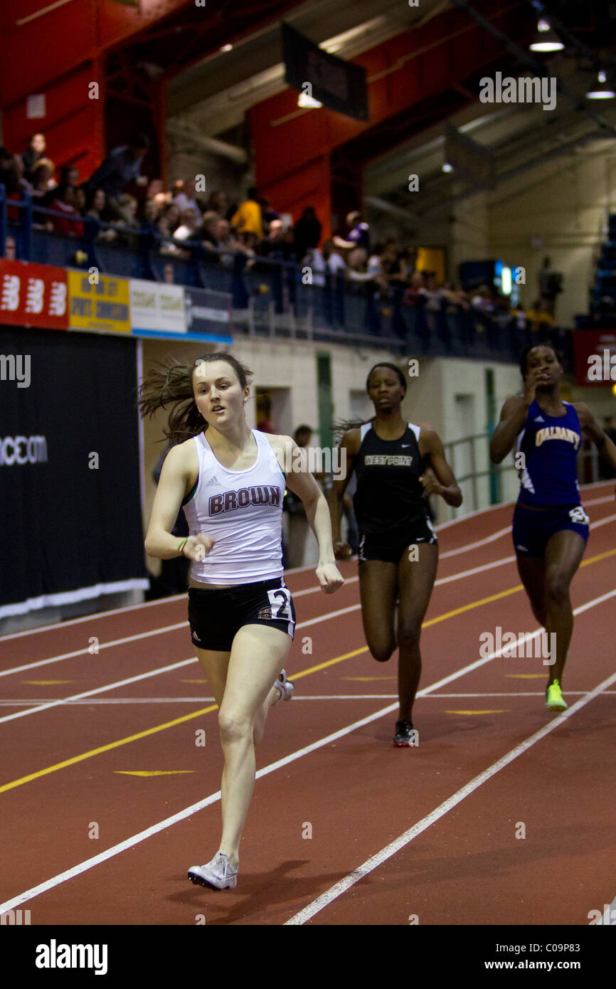 College Women's Track and Field Race. - Stock Image