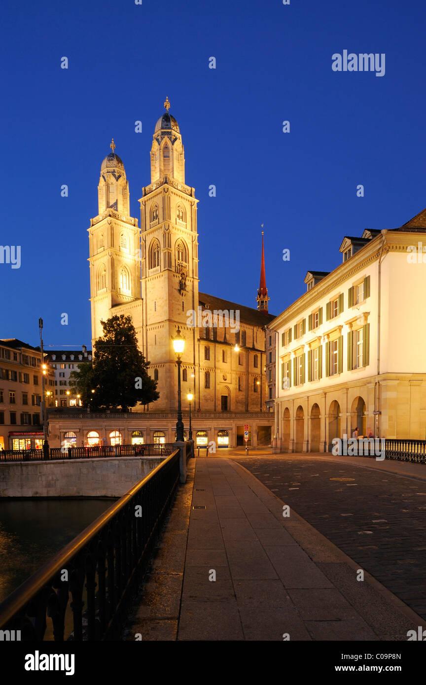 Grossmuenster minster and Helmhaus annex at night, Zurich, Switzerland, Europe - Stock Image