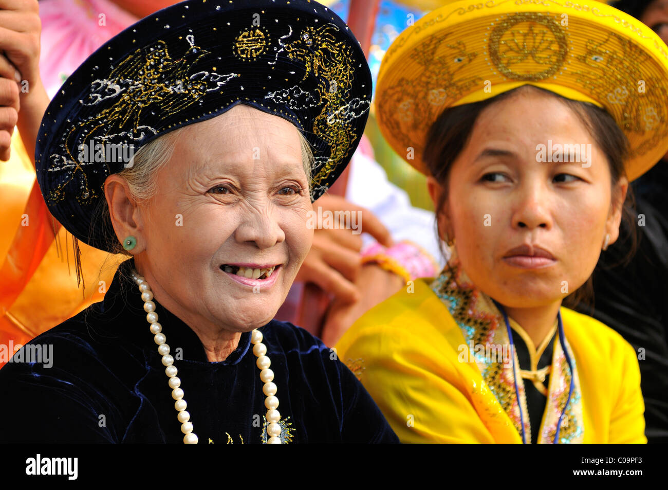 Traditionally dressed women in gorgeous robes at the most important festival of the Cham, Po Nagar temple, Nha Trang, - Stock Image