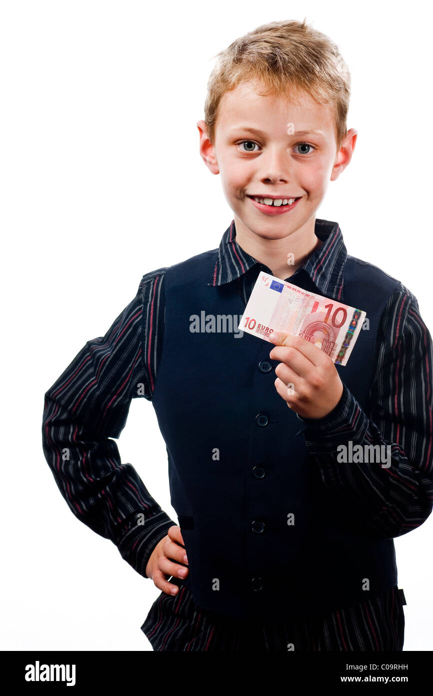 A boy, 8 years, with a 10 euro note in his hand - Stock Image