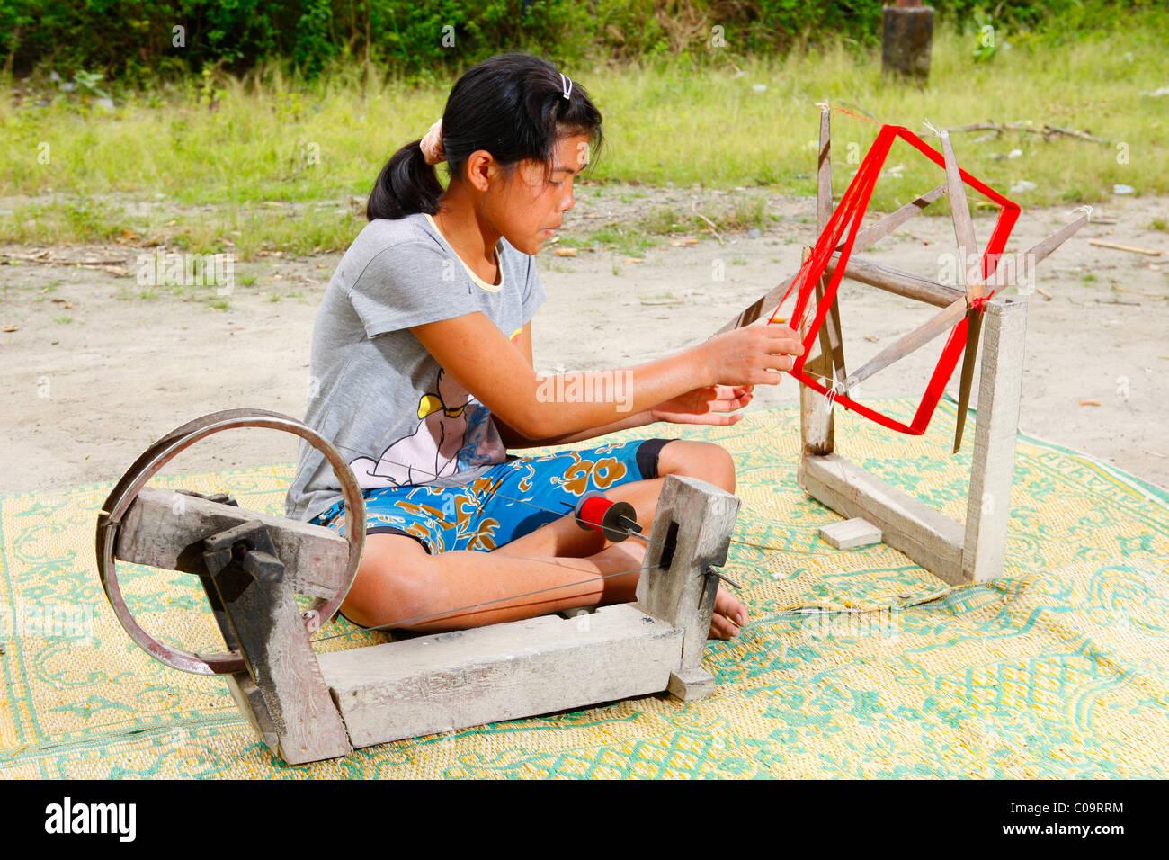 Female spinner, Batak culture, Samosir Island, Lake Toba, Batak region, Sumatra, Indonesia, Southeast Asia, Asia - Stock Image