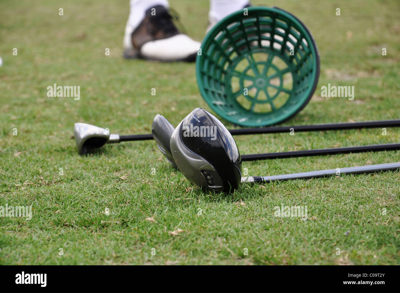 Golf Clubs at the driving range - Stock Image