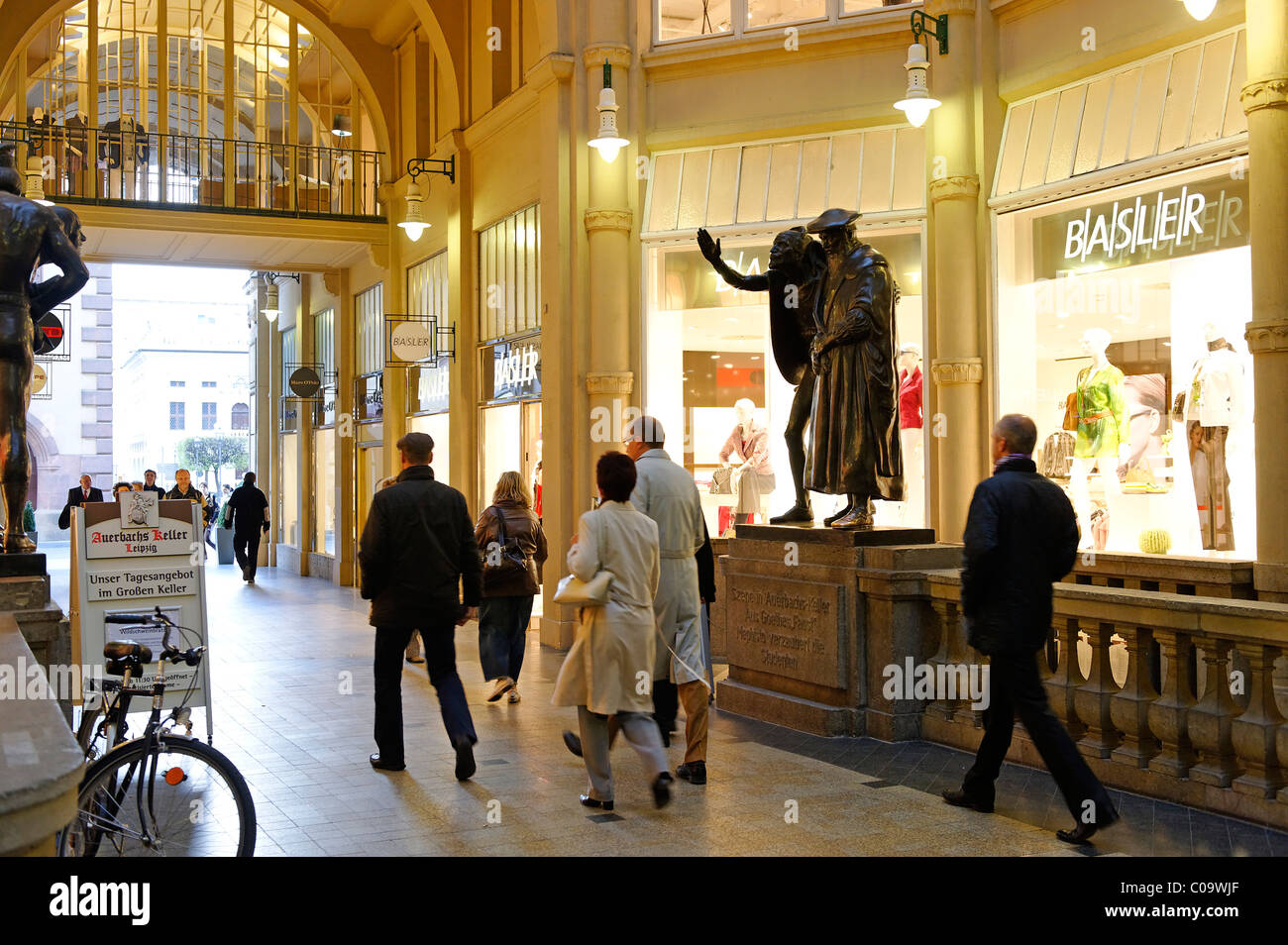 Faust and Mephisto in front of Auerbach's Keller, Maedler Passage shopping arcade, Leipzig, Saxony, Germany, - Stock Image