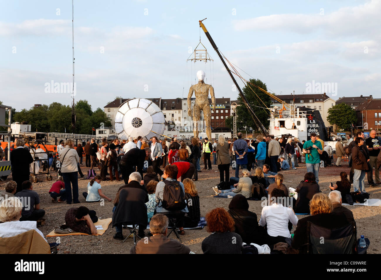 Spectators on the Mercatorinsel island waiting for Global Rheingold, open-air theater by La Fura dels Baus, Duisburg - Stock Image