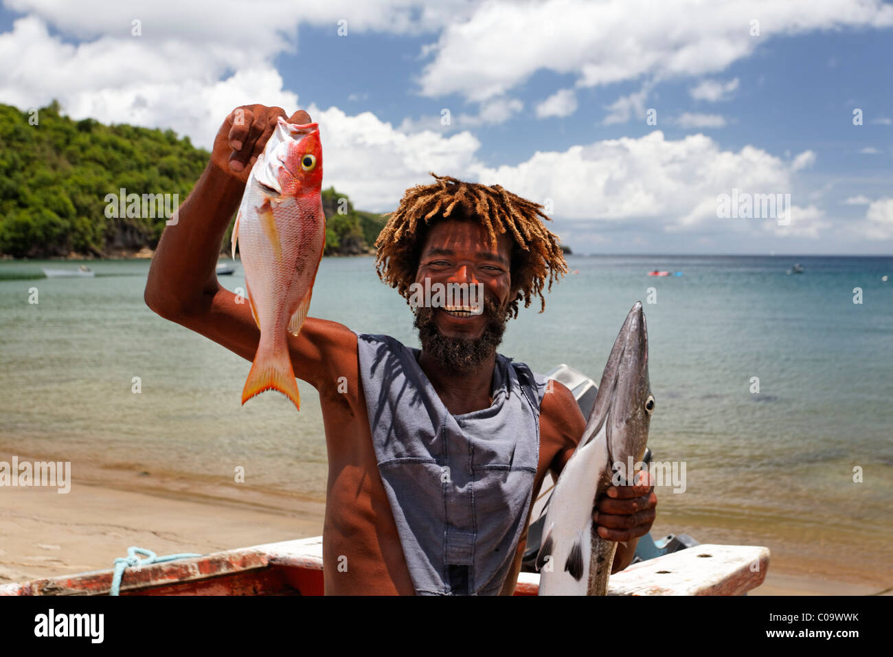 Saint Lucian fisherman proudly showing his catch of the day, Barracuda (Spyraena barracuda) and Red Snapper (Lutjanus - Stock Image