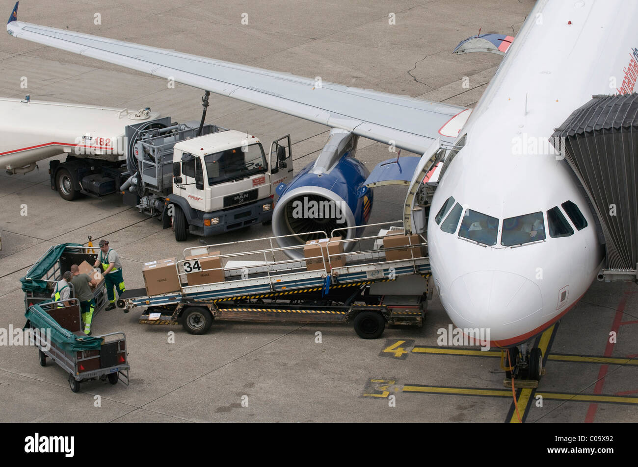 Airplane being refueled and loaded on the manoeuvering area, air cargo, Duesseldorf Airport, North Rhine-Westphalia - Stock Image