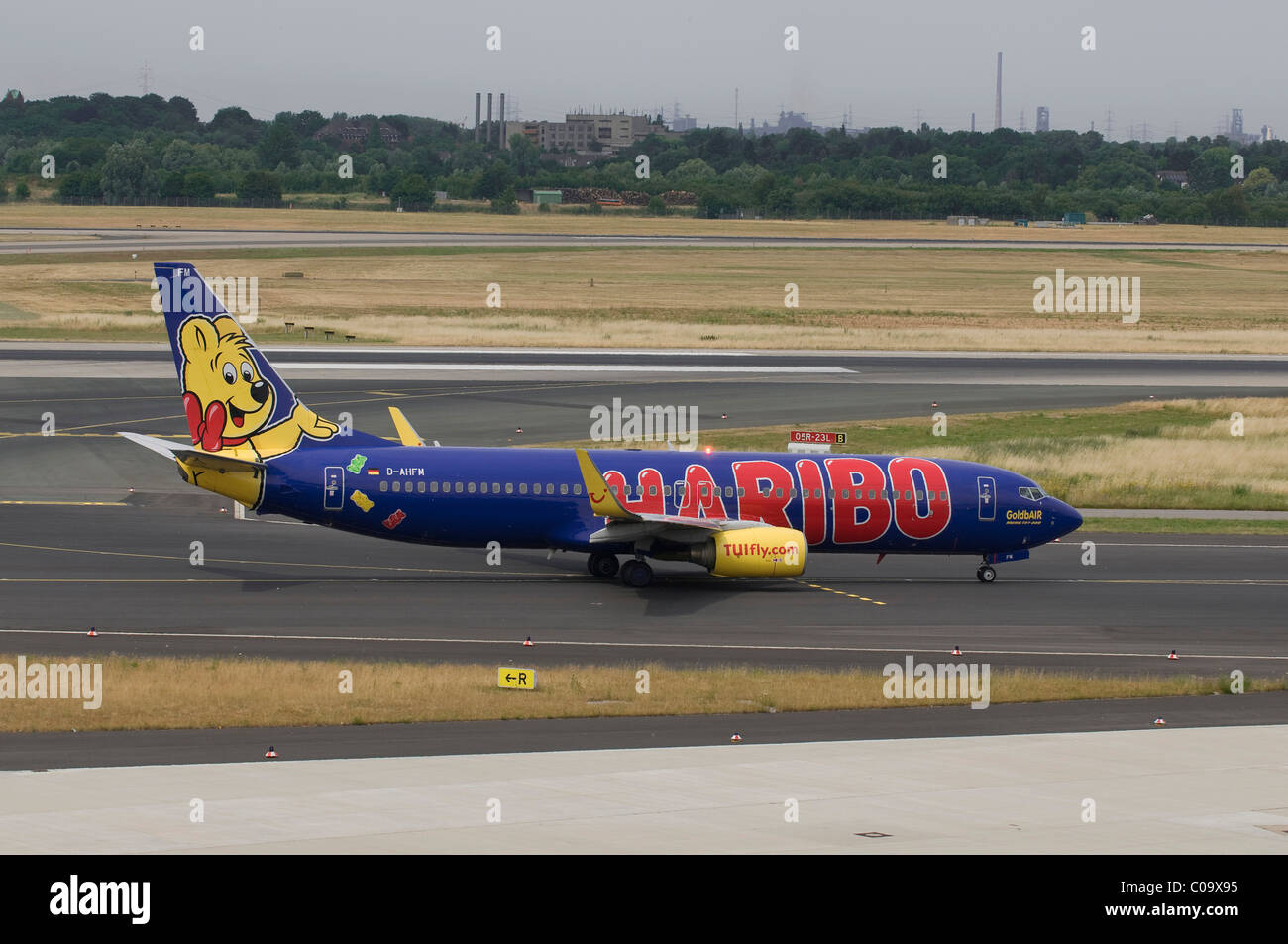 Haribo Logojet TUIfly Boeing 737-800, GoldbAIR on the runway of the Duesseldorf Airport, North Rhine-Westphalia, - Stock Image