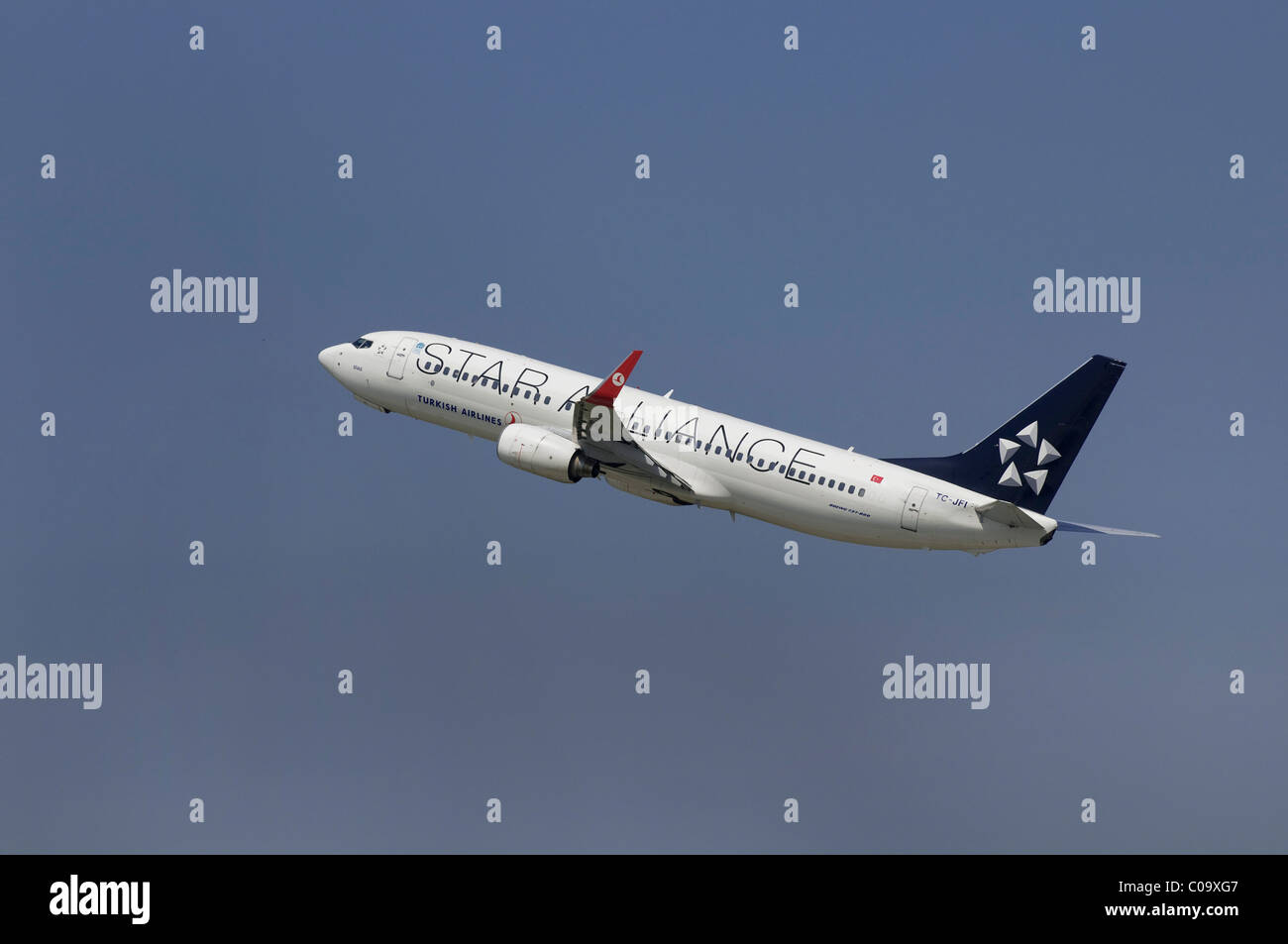 Commercial aircraft, climb, Turkish Airlines in European 'Star Alliance', with special painting - Stock Image