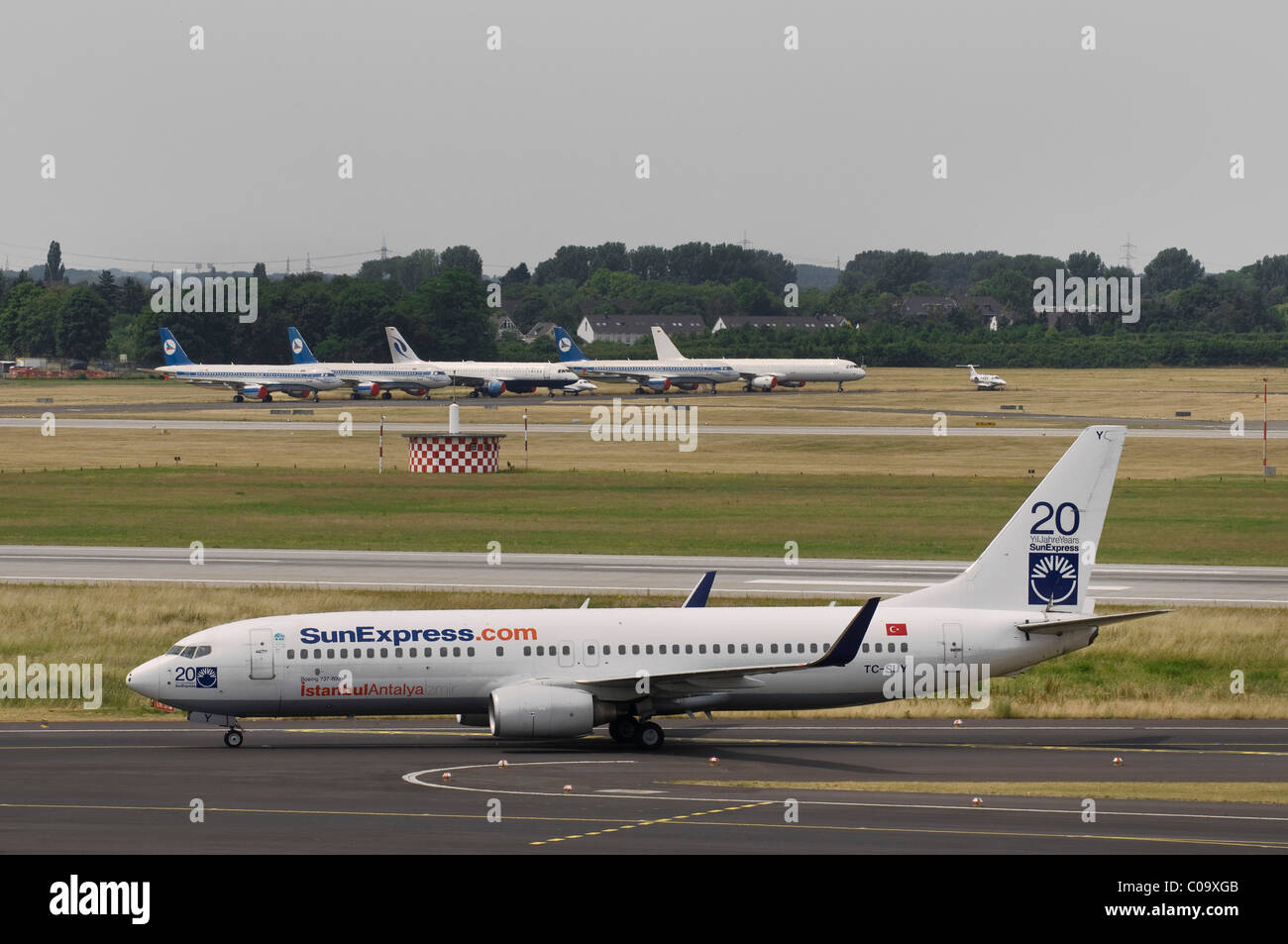SunExpress Boeing 737-800 on the runway, planes in the back, Duesseldorf Airport, North Rhine-Westphalia, Germany, - Stock Image