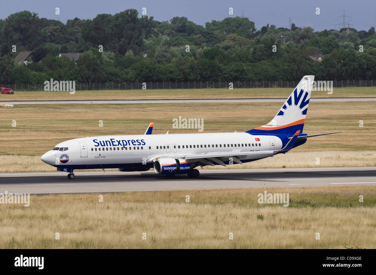 SunExpress aircraft, Boeing 737-800, on the runway of Duesseldorf Airport, North Rhine-Westphalia, Germany, Europe - Stock Image