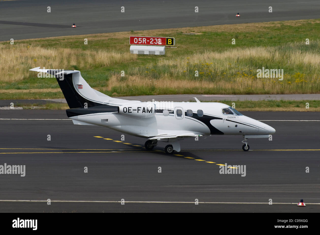 Very Light Jet, corporate jet, Embraer EMB-500 Phenom 100 on the manoevering area, Duesseldorf Airport, North Rhine - Stock Image