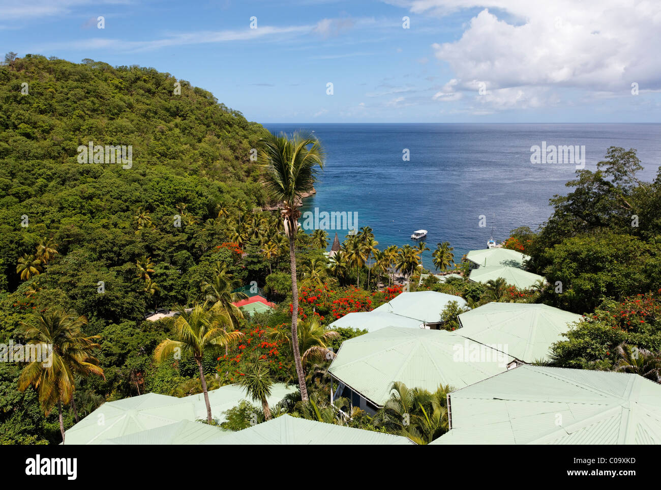 Public Anse Chastanet Bay with roofs of the Luxury Hotel Anse Chastanet Resort, Sea, LCA, St. Lucia, Saint Lucia Stock Photo