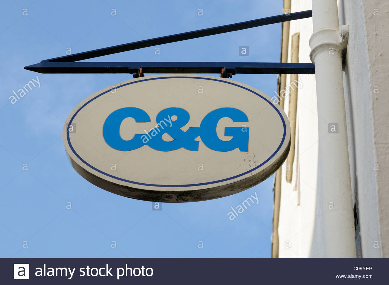 Looking up at a hanging C&G Bank sign in Sherborne, Dorset, England - Stock Image