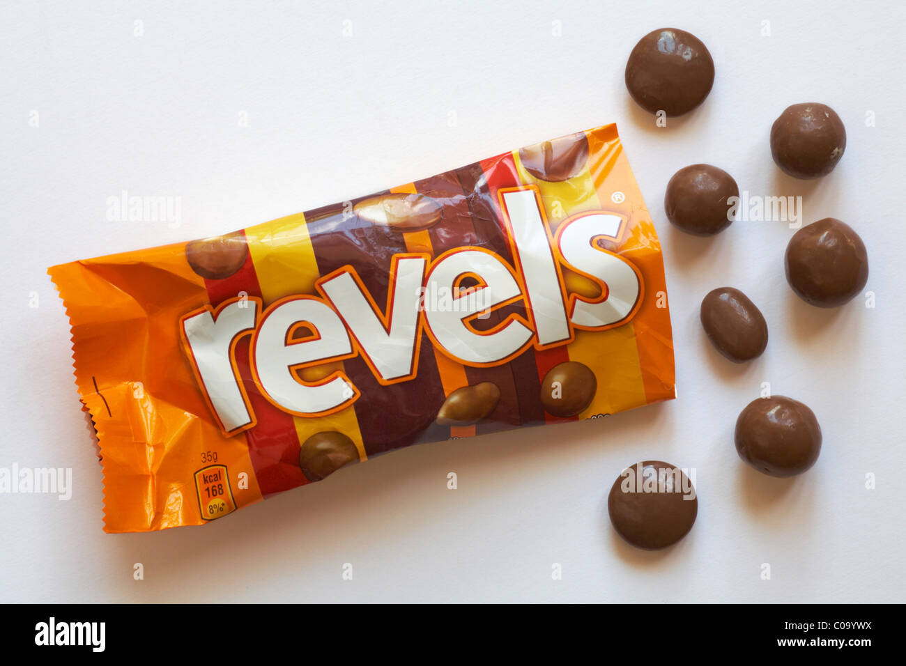 bag of Revels with contents spilled isolated on white background - Stock Image