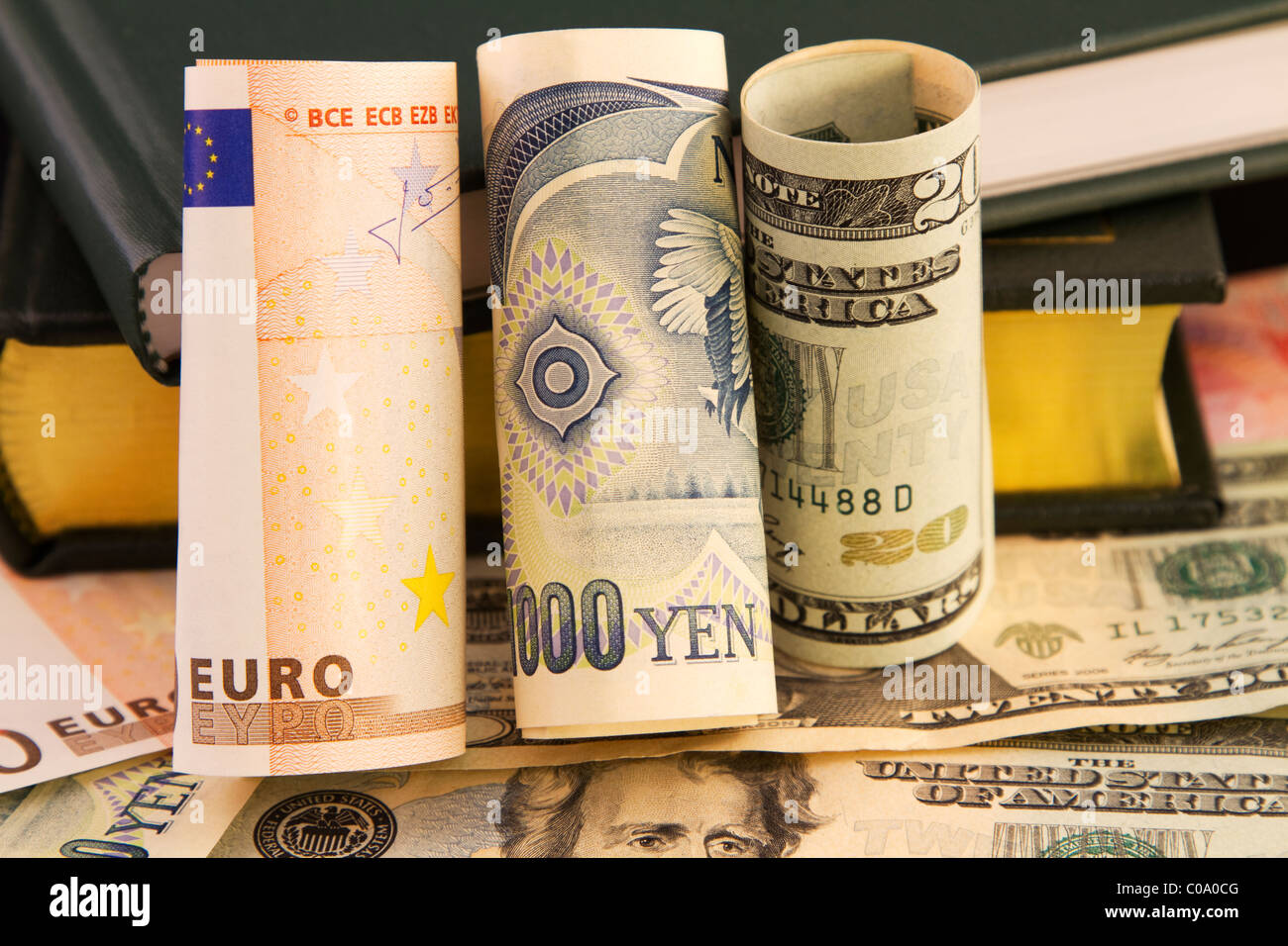 Multiple global currencies and books connect knowledge and data-driven, strategic global currency analysis to business. - Stock Image
