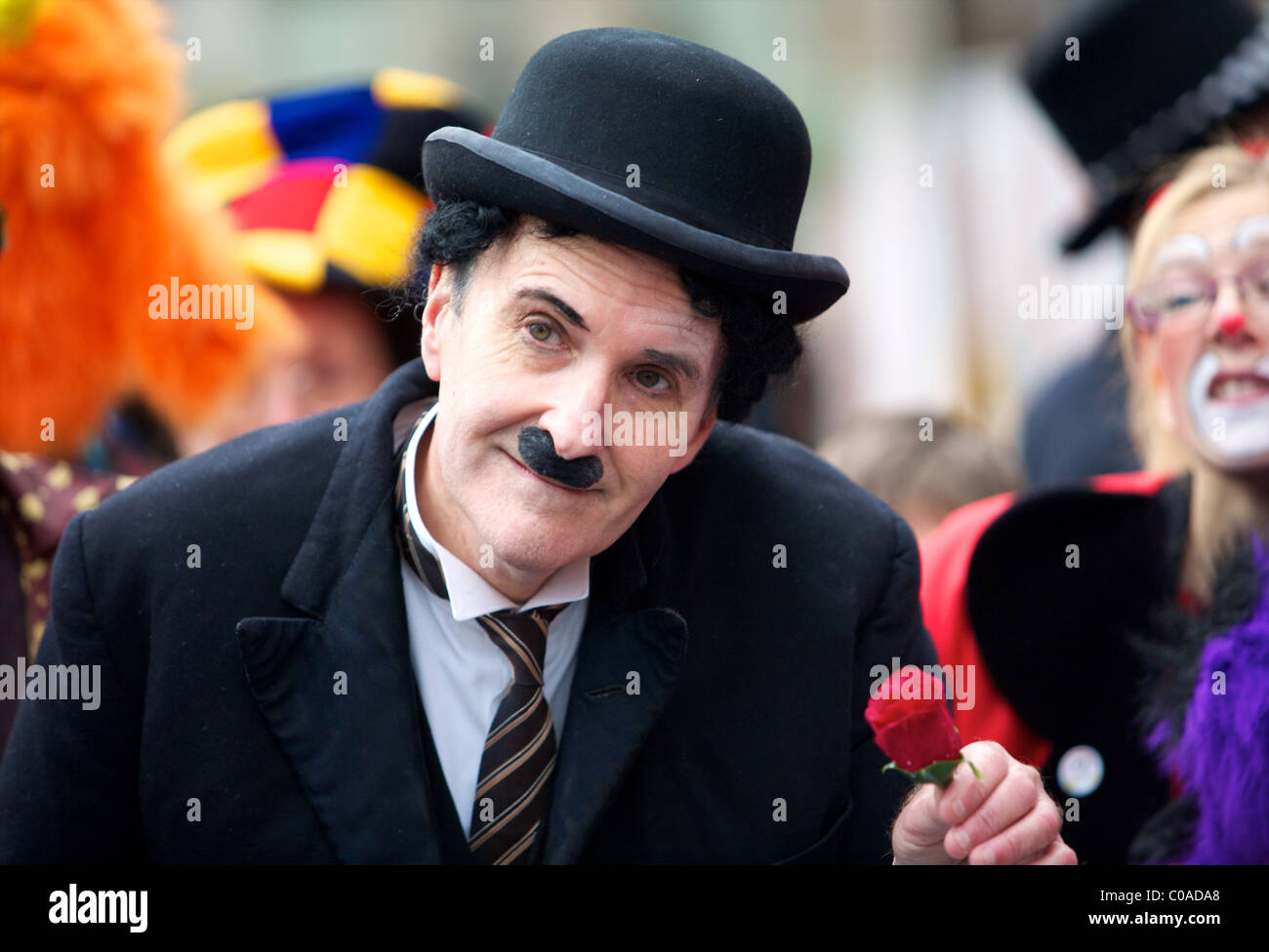 Clown dressed as Charlie Chaplin - Stock Image