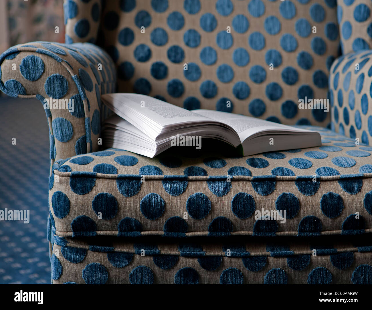 Armchair with open book - Stock Image