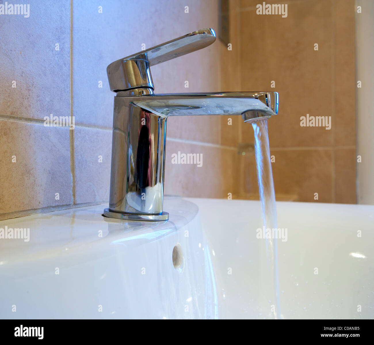Mixer Tap with running water - Stock Image