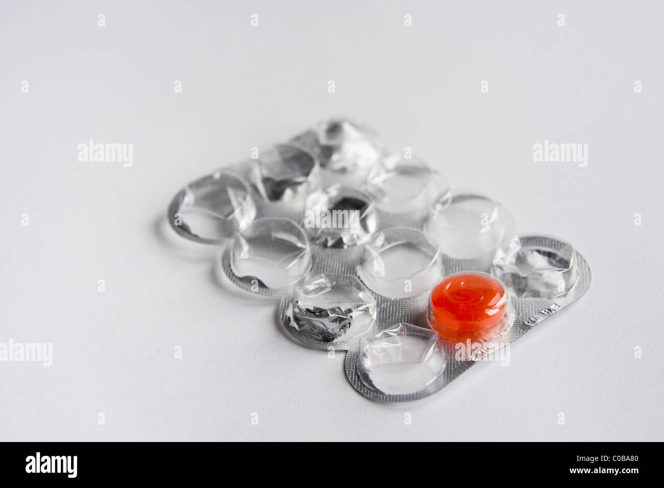 throat lozenge packet with one remaining - Stock Image