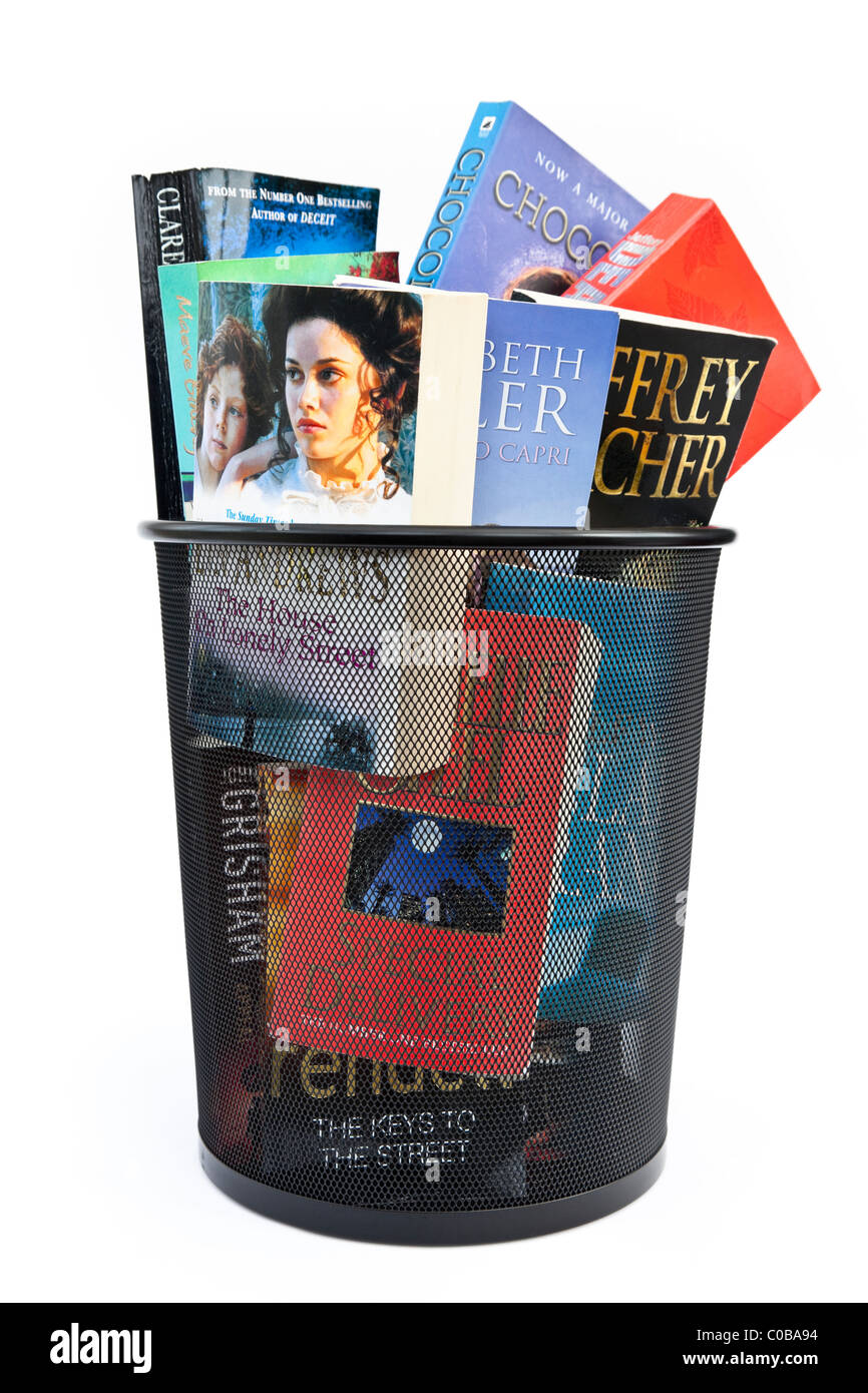 Paperback books thrown away in a wastepaper bin to illustrate concept of change to ebooks. England UK - Stock Image