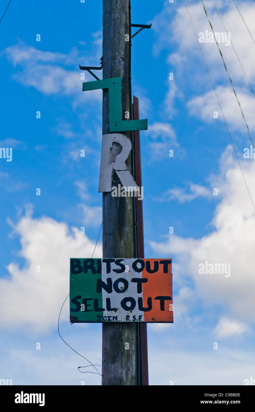 Old battered IRA sign on a lamppost in West Belfast.  'Brits out, not sell out.  Join RSF' (Republican Sinn - Stock Image