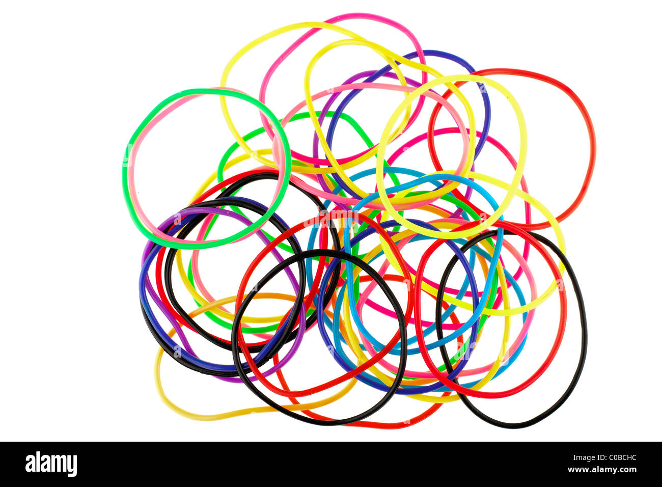 Pile of multicoloured rubber friendship bands - Stock Image