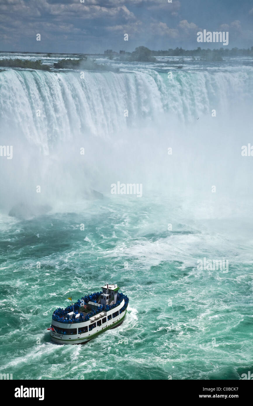 Tourist boat heading into the spray of Niagara Falls, Canada - Stock Image