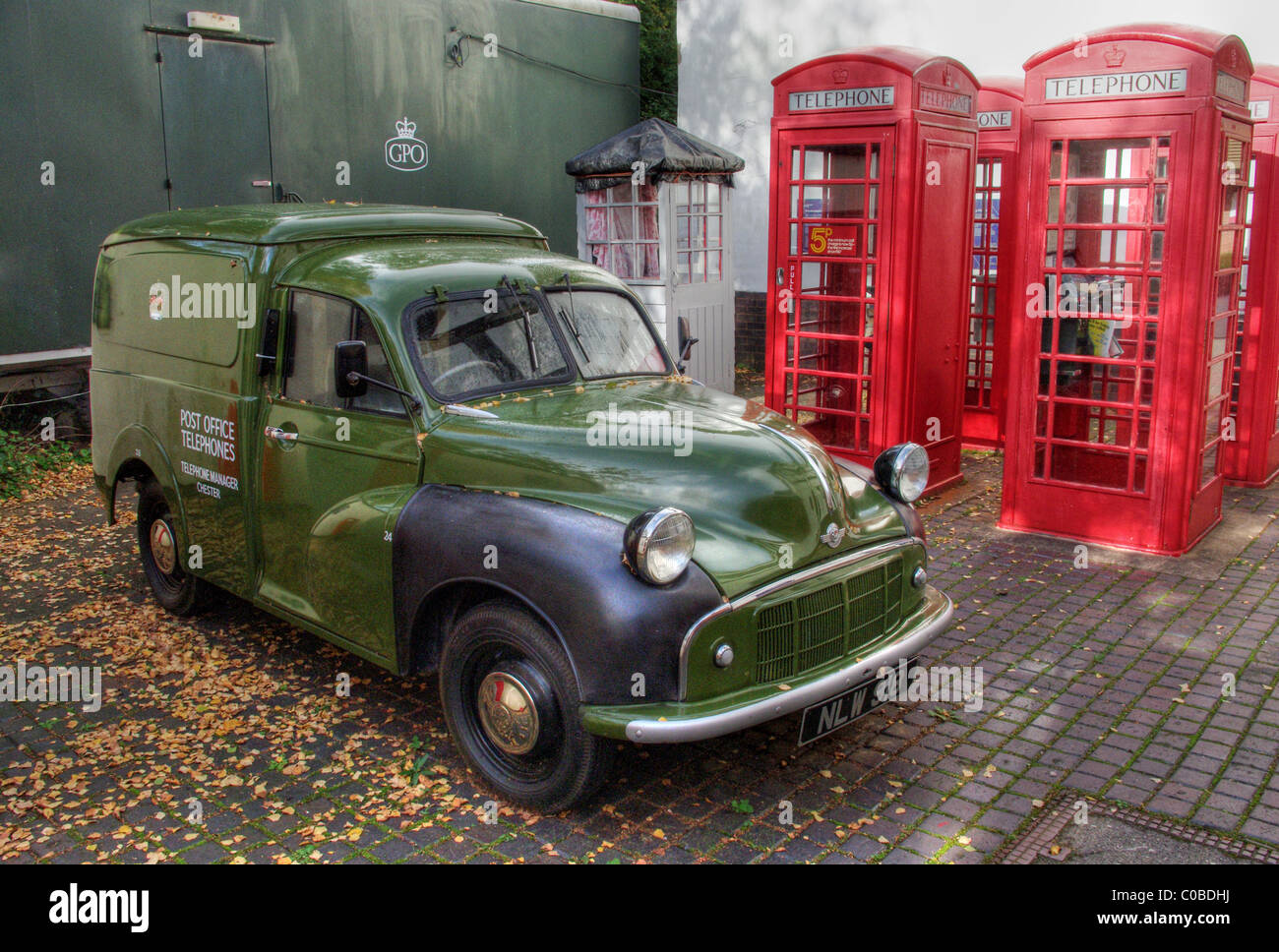 Green GPO van against a backdrop of red phone-boxes at Avoncroft Museum of Historic Buildings - Stock Image
