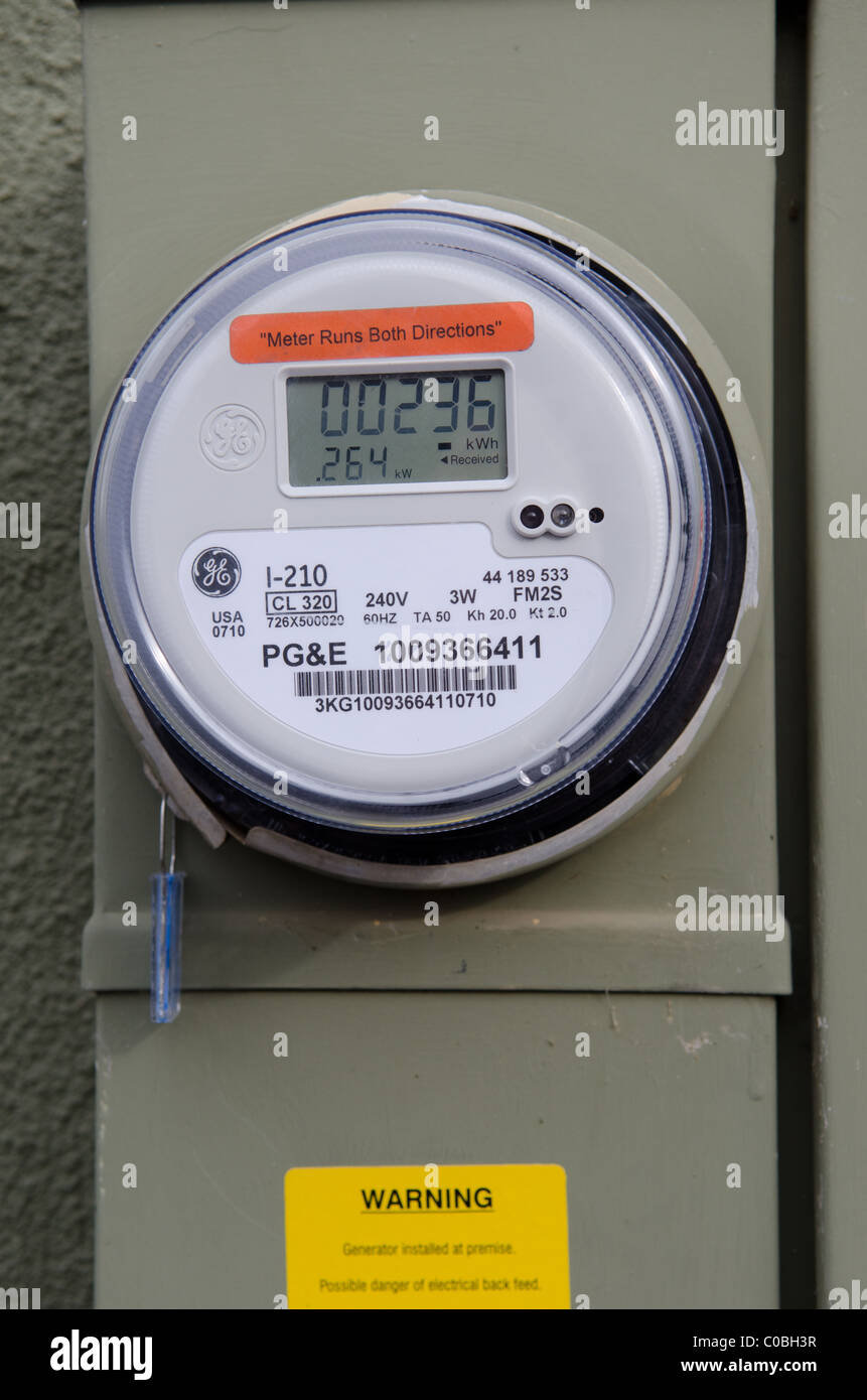 GE power meter for use with a residential solar power generator system measures the electricity used and the amount Stock Photo