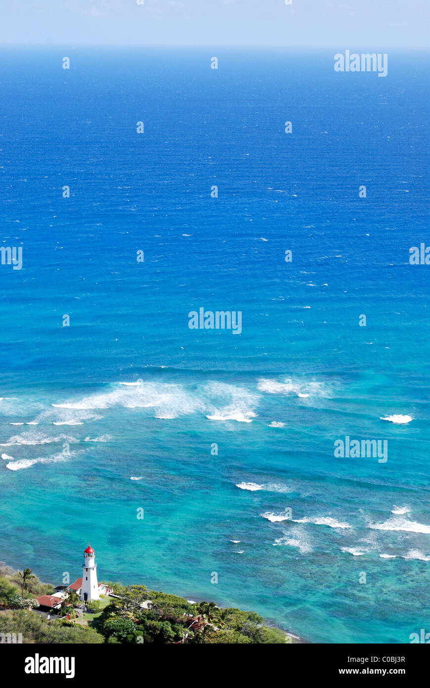 Diamond Head Lighthouse looking out onto vast blue ocean. Windward Coast of Oahu Hawaii shot from diamond head crater. - Stock Image