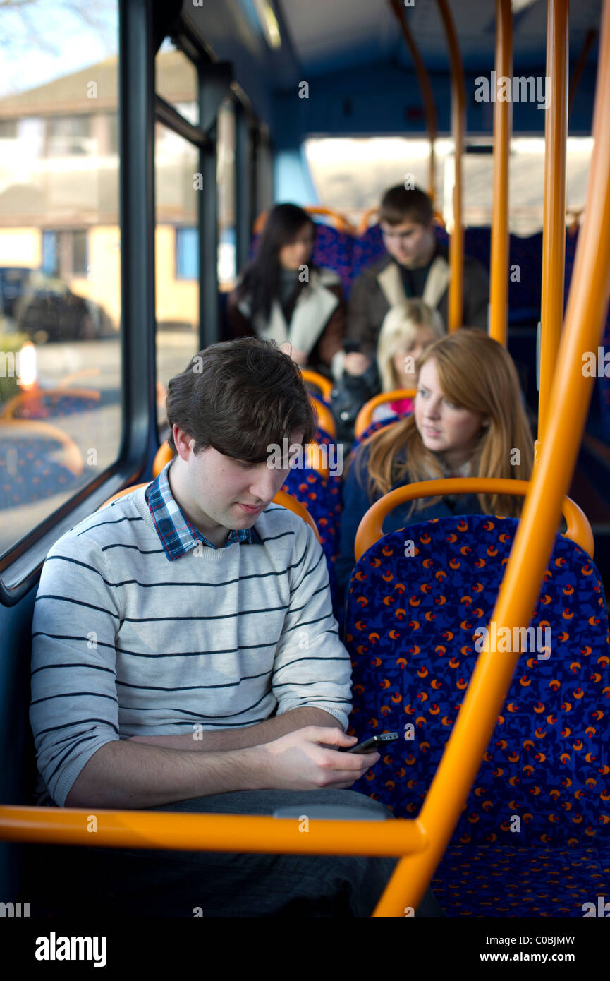 young international students traveling on a university campus bus - Stock Image