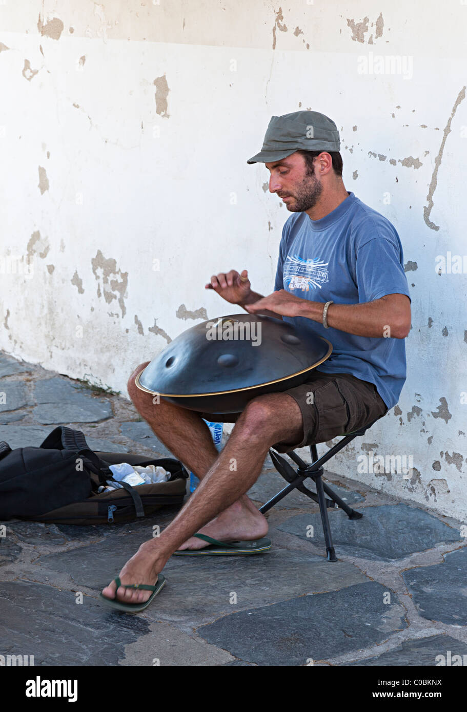 Man playing a hang musical instrument for tips in seaside town of Cadaqués Emporda Catalunya Spain - Stock Image