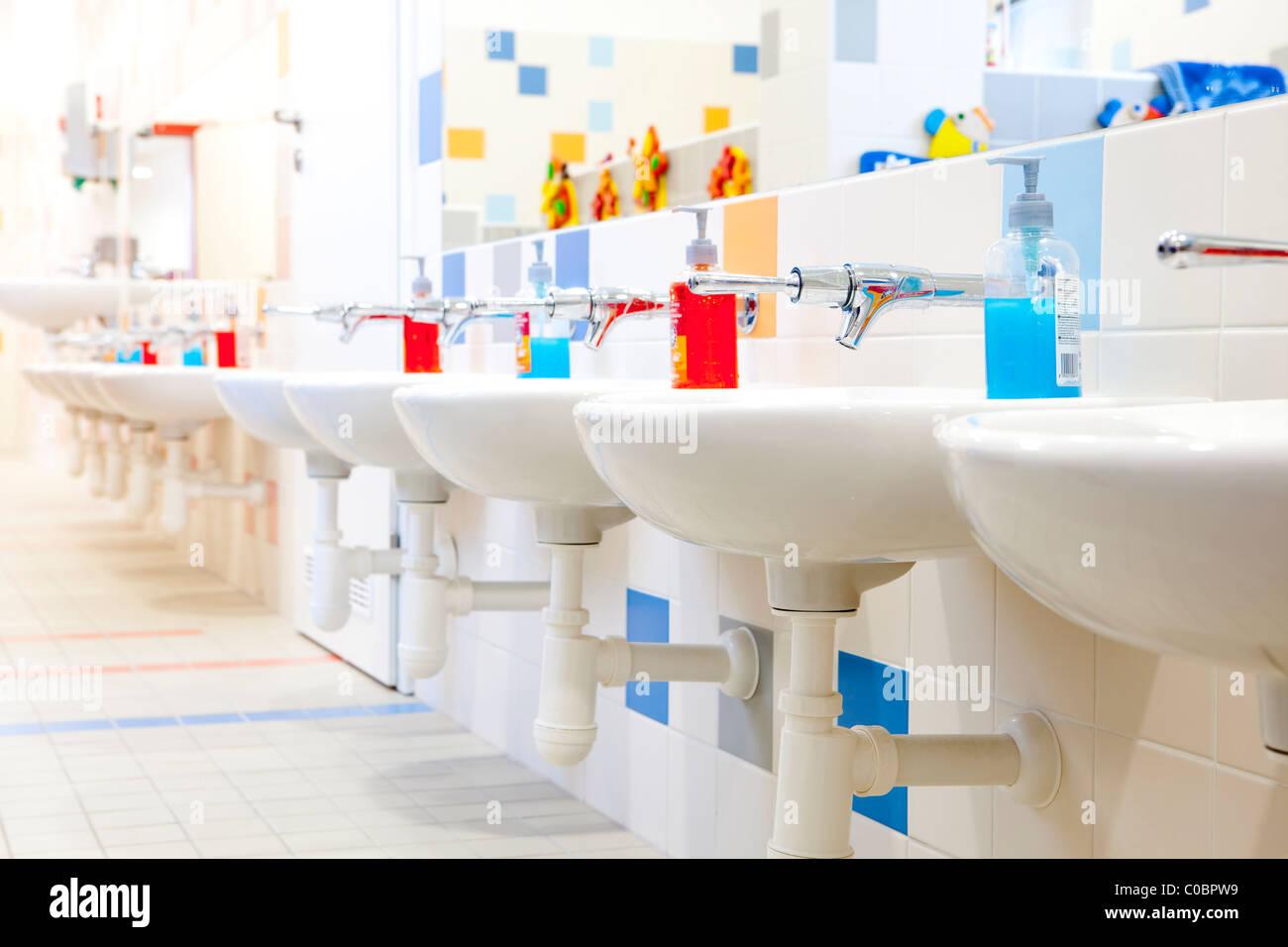 czech republic, prague - interior of modern bathroom in kindergarten - Stock Image