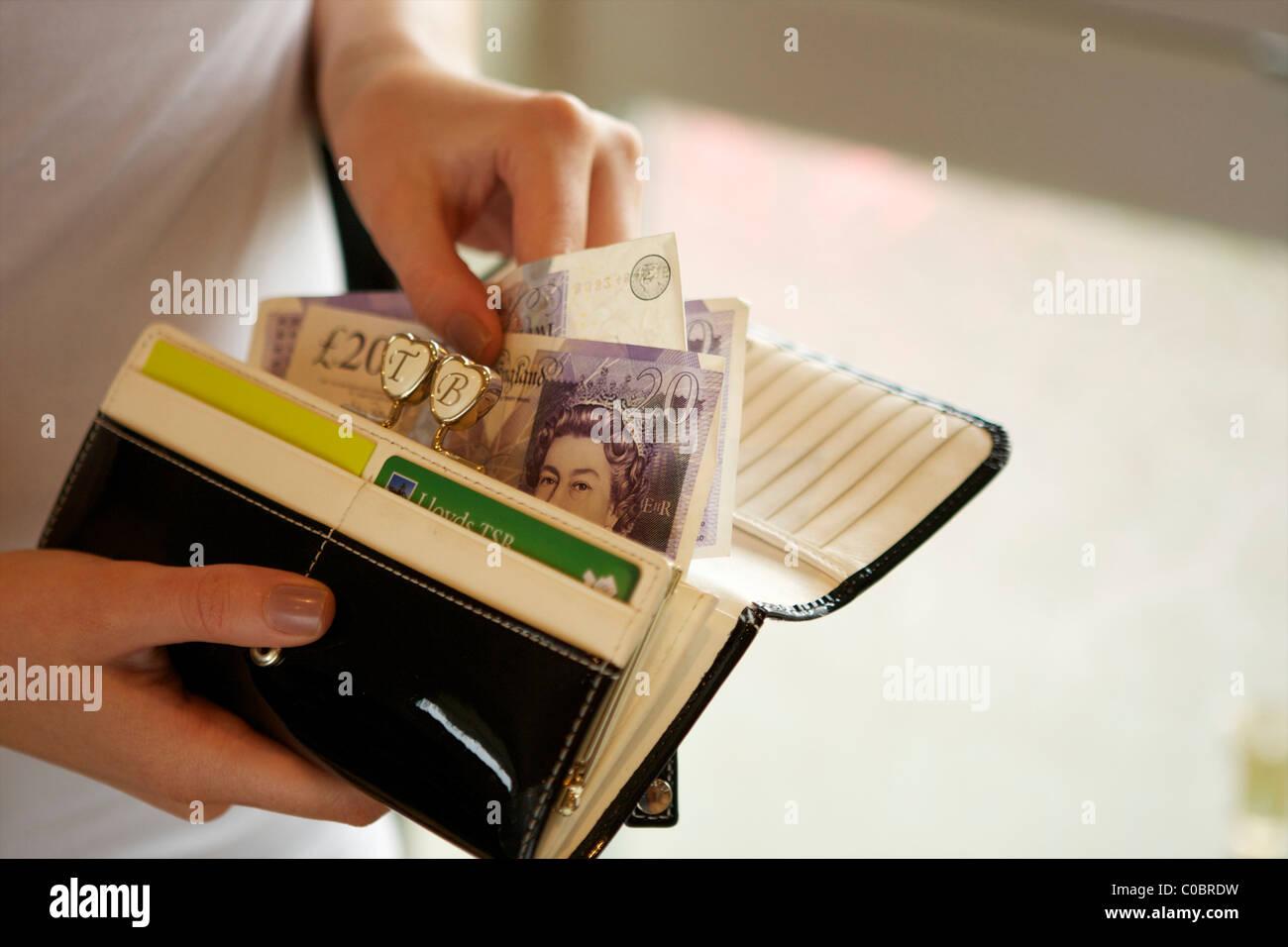 female holding purse - Stock Image