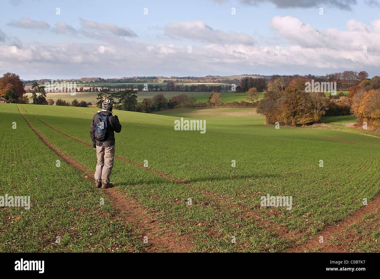 Rambler walking the Clarendon Way, near Winchester, Hampshire, England, UK Stock Photo