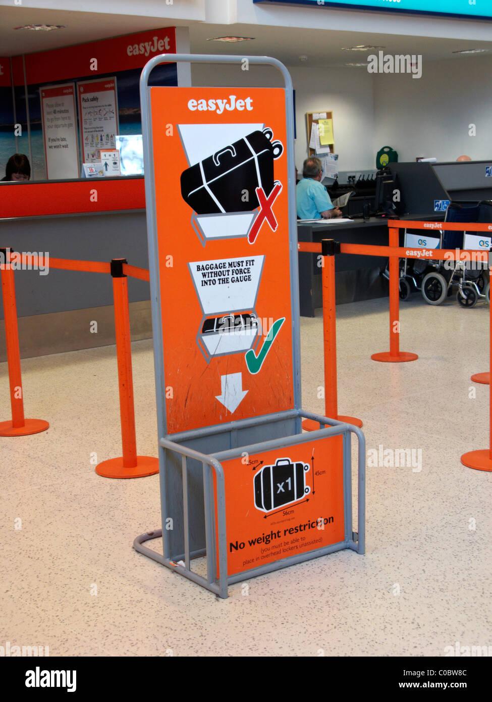 easyjet cabin baggage size gauge at Belfast International Airport Northern Ireland - Stock Image