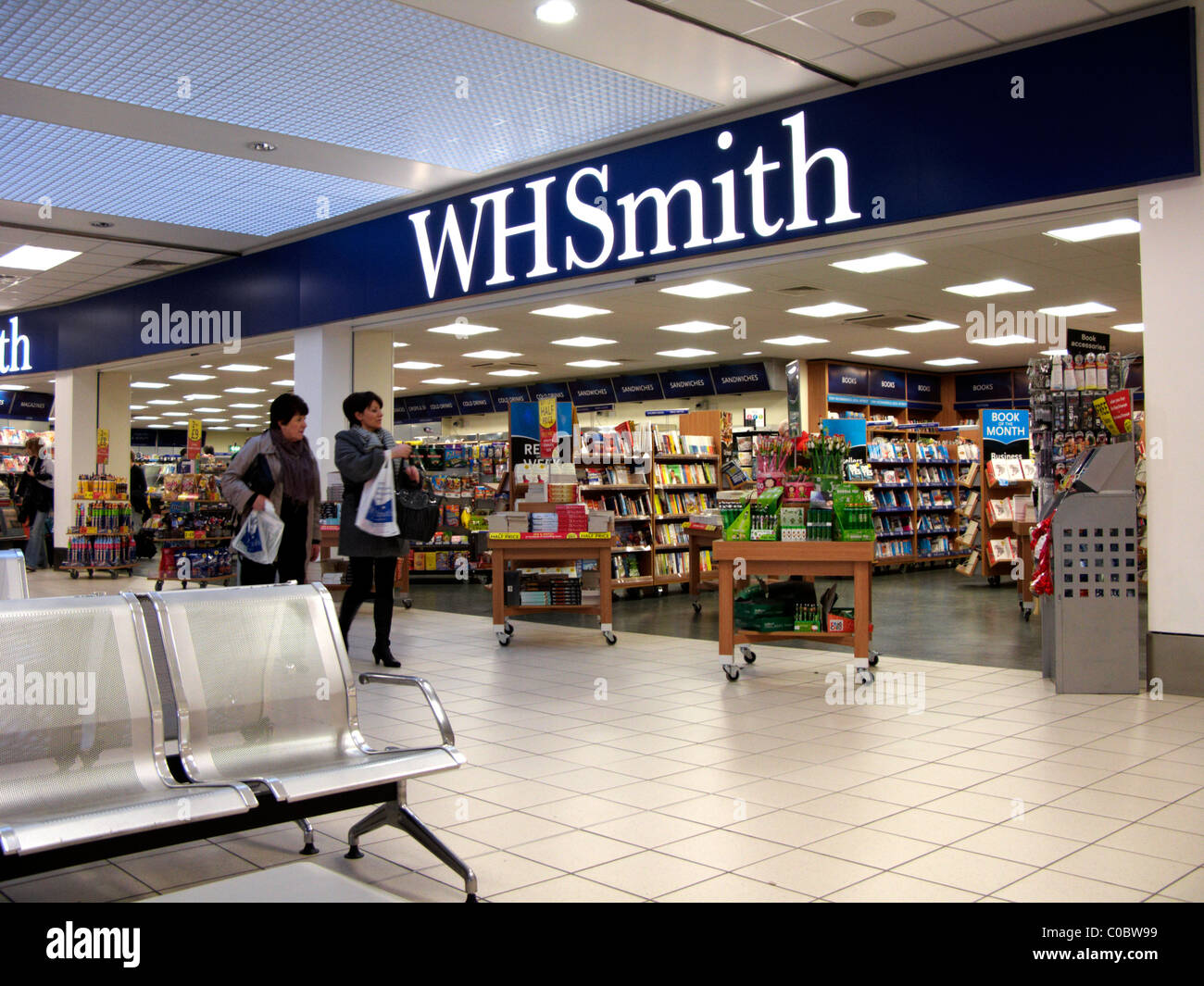 WH Smith newsagent shop at Belfast International Airport Northern Ireland - Stock Image