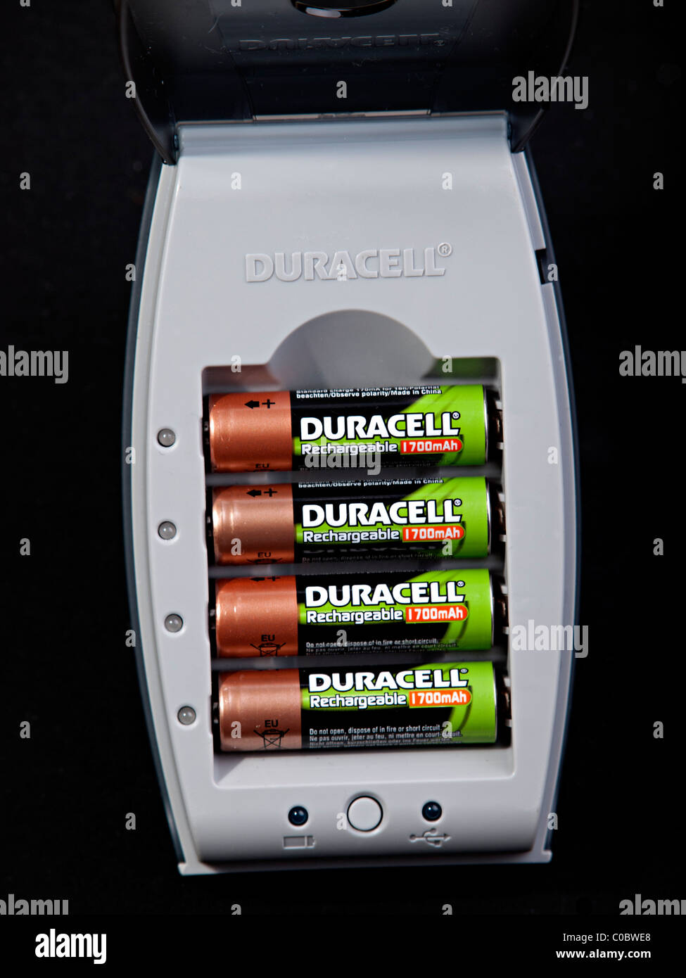4 rechargeable batteries in a Charger - Stock Image