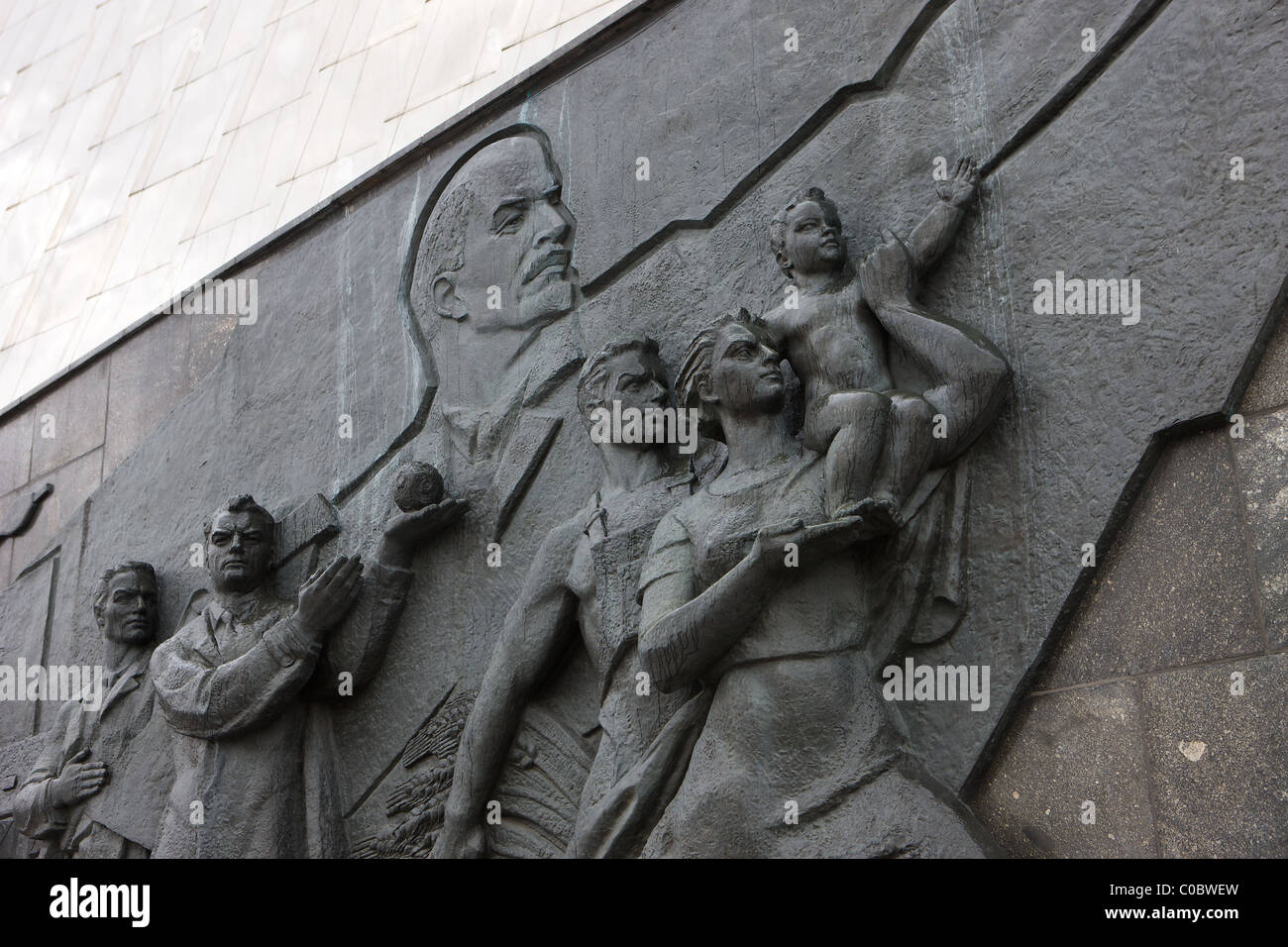The base of the Space Obelisk monument, Moscow, Russia. Lenin leads the masses into space as a woman offers her Stock Photo